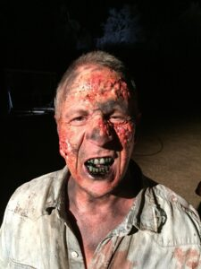Actor and stuntman Jeff Bornstein in full zombie make-up for the movie The Clearing, with actor Liam McIntyre