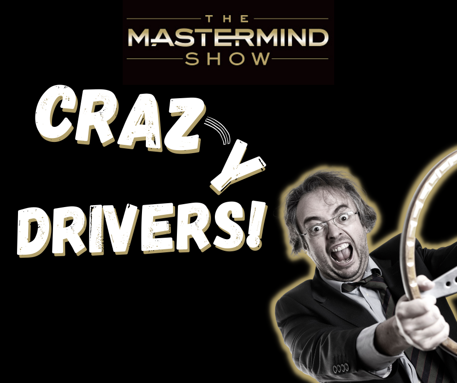 Crazy looking driver with a steering wheel in his hands